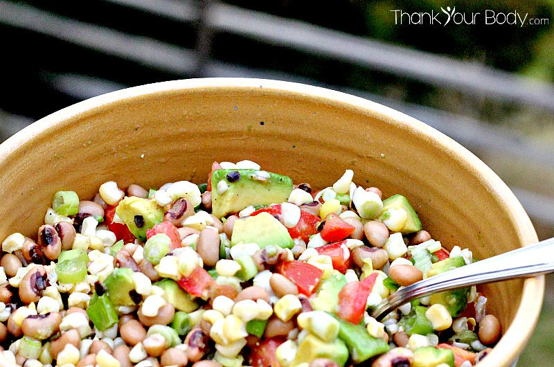 Cowboy Caviar: A delicious medley of avocado, fresh tomato, corn and black eyed peas!