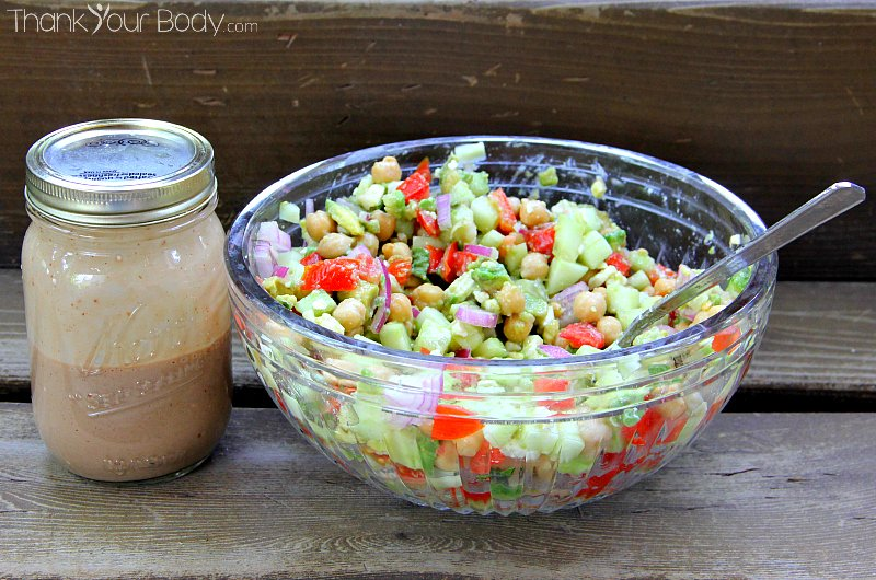 Try this chickpea salad with tomatoes and feta, tossed with a creamy ...