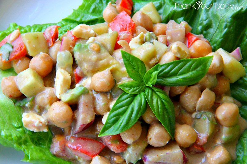 Try this chickpea salad with tomatoes and feta, tossed with a creamy balsamic dressing!
