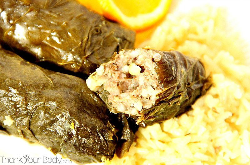 Delicious stuffed grape leaves with meat, pine nuts, currents, and savory Mediterranean spices.